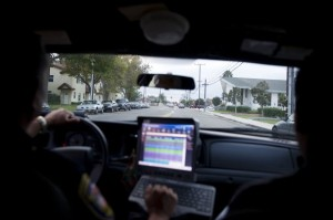 PHOTO BY TROY HARVEY, VENTURA COUNTY STAR TROY HARVEY/THE STAR Sgt. Alex Rangel patrols Oxnard's La Colonia neighborhood Tuesday evening.