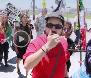 "Colectivo Todo Poder al Pueblo member on bullhorn: ""How do you spell murderer?""  Crowd replies: ""S-P-D""  Woman monitoring the march while wearing a white armband and yellow backpack walks up to demonstrator on bullhorn and says: ""Watch your language. Watch your language, okay."" see below video at 4:08)"