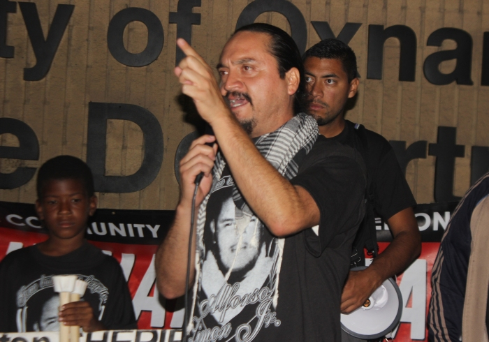 Francisco Romero speaks at Oxnard Police Department during anti-brutality march October 12, 2014 (credit: Agatha Muñoz)