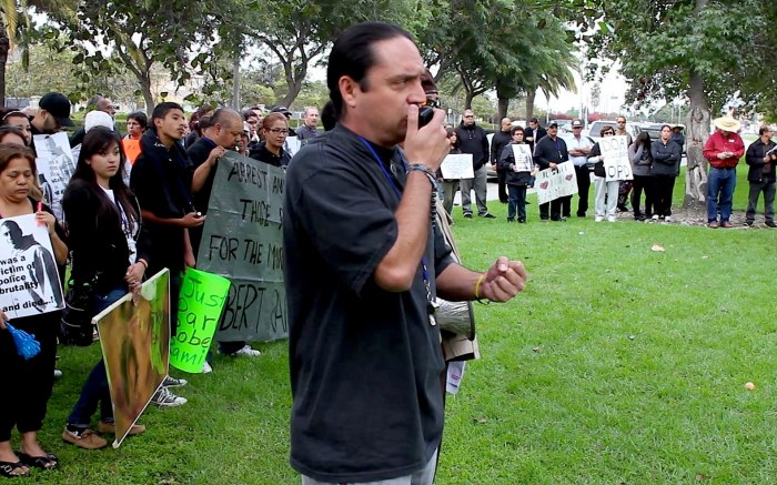Francisco Romero speaks at a march held for the National Day of Action Against Police Brutality, 10/22/12 (TODO PODER AL PUEBLO MEDIA OPERATIONS)
